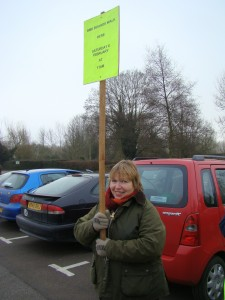 Hilary holding a board to mark the start of the boards walk